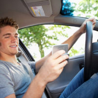 Teen boy distracted while driving