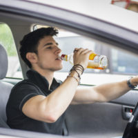 Boy drinking & driving