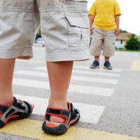Little boy using crosswalk