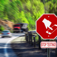 Red sign that says stop texting.jpg.crdownload