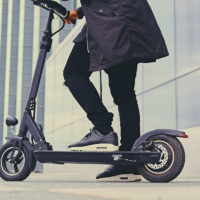 Close up image of a man on an electric scooter