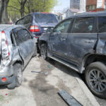 big cars accident on the road in the city, broken cars closeup, traffic accident, multiple car crash