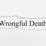 Wrongful Death on white torn paper