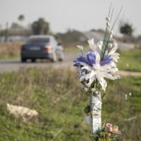 Memorial bouquet at the site of a road accident