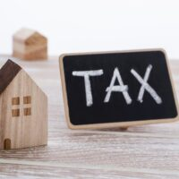 Houses with tax sign